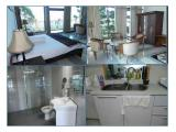 Bedroom, bathroom, seating area and kitchen